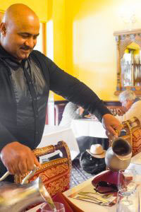 Taj Of Marin - Updated Hours - Man pouring water on glasses