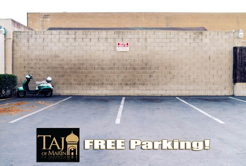 Taj of Marin - Free Parking - Parked motorcycle on a parking lot, logo and text.